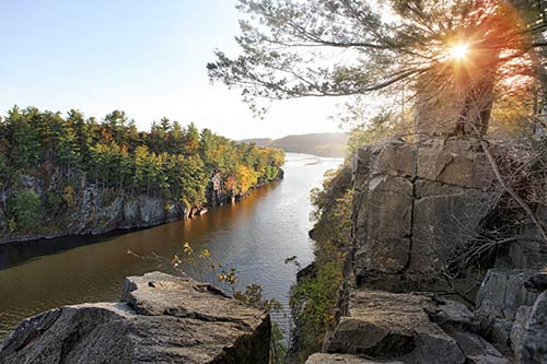 Wisconsin River cutting through rocks with sun setting